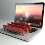 Video player app or home cinema concept. Laptop and seats